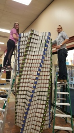 Katie and Jacob stacking cans